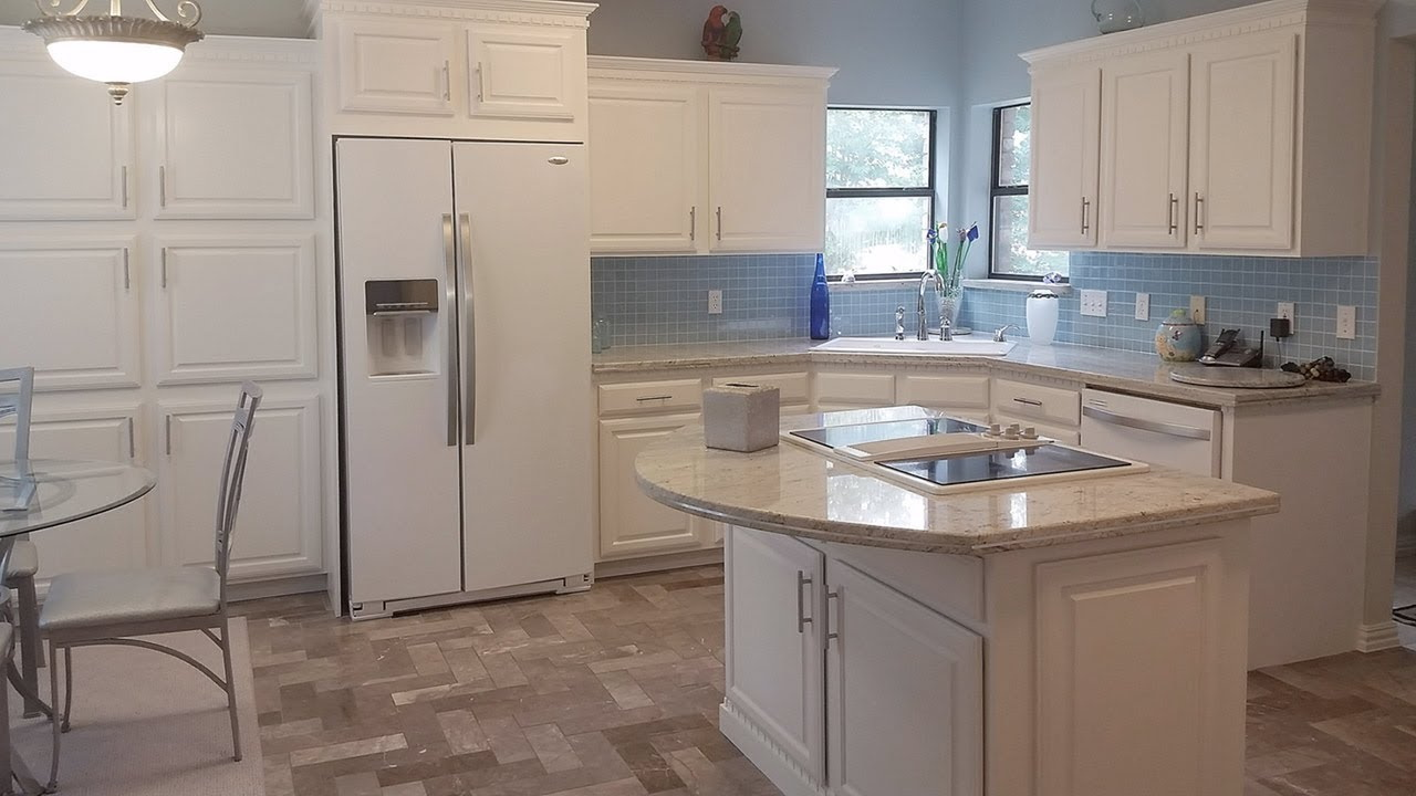 whitewashed wooden kitchen cabinets